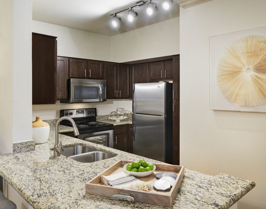 ... Kitchen With Granite Countertops And Stainless Steel Appliances At  Camden Breakers Apartments In Corpus Christi, ...