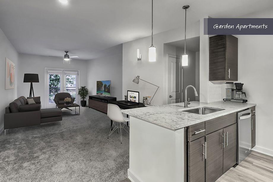 Garden Apartments Living Room and Dining Area at Camden Brookwood Apartments in Atlanta GA