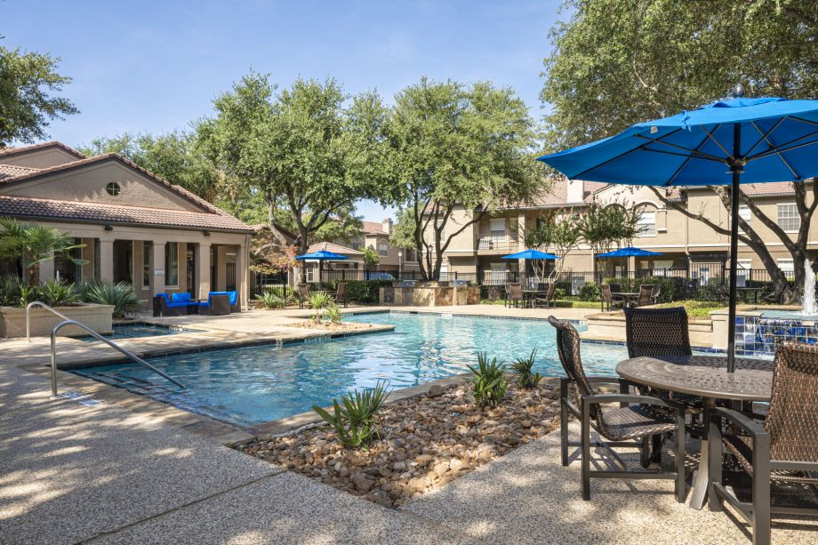 Pool and Tables at Camden Cimarron Apartments in Irving, TX