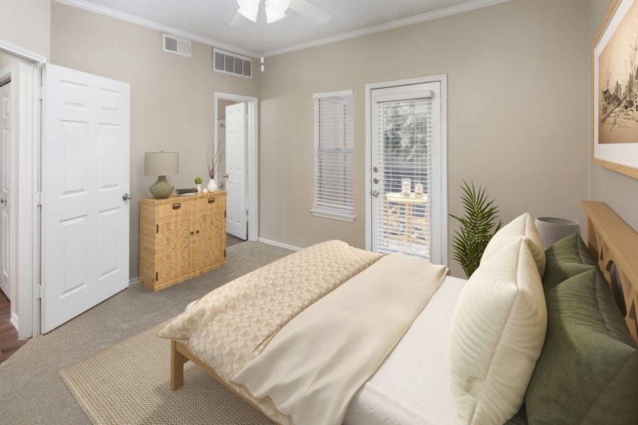 Bedroom with Attached Balcony and Bathroom at Camden Cimarron Apartments in Irving, TX