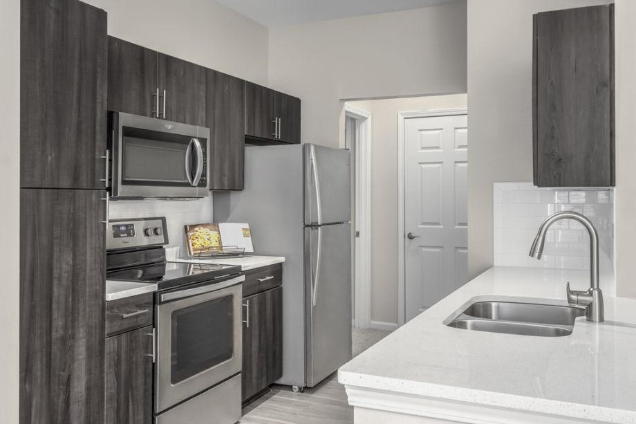 Kitchen with Stainless Steel Appliances at Camden Creekstone Apartments in Atlanta, GA