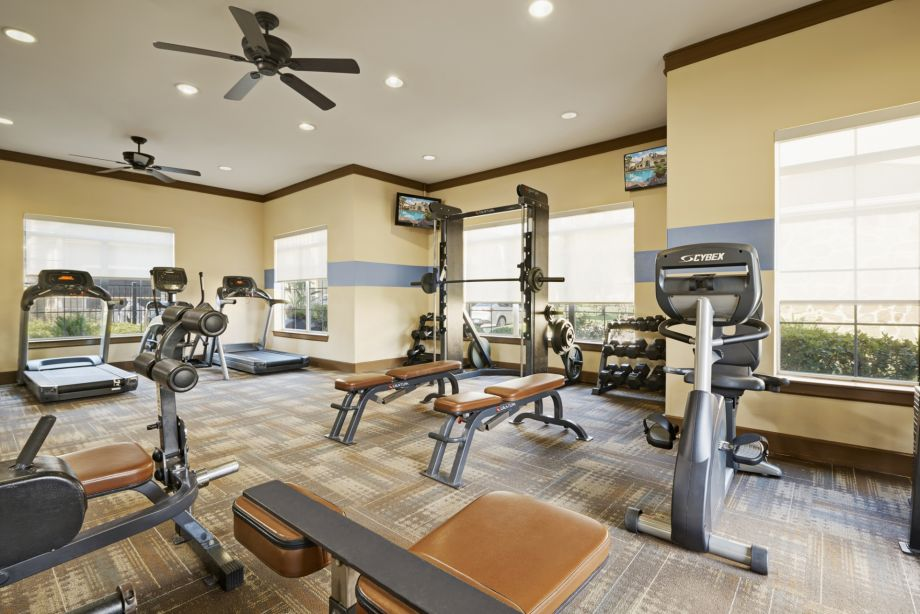 Fitness Center with Cardio and Free Weights at Camden Downs at Cinco Ranch Apartments in Katy, TX