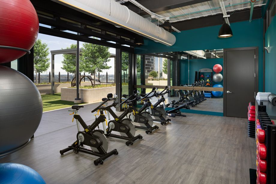 Fitness center with stationary bikes at Camden Downtown Houston apartments in Houston, Texas