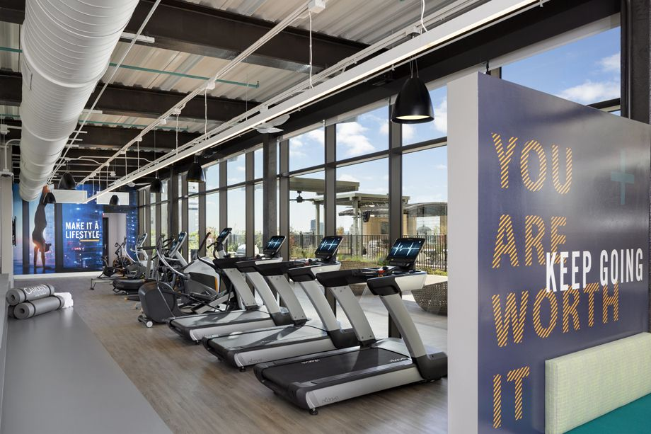 Fitness center with cardio machines at Camden Downtown Houston apartments in Houston, Texas