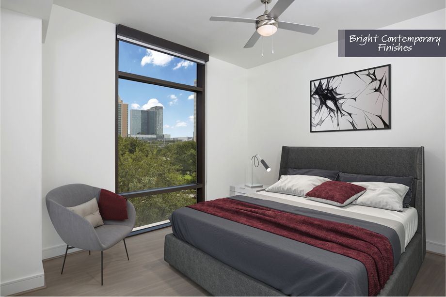 Bedroom with Downtown views with bright contemporary finish scheme at Camden Downtown Houston Apartments in Houston, Texas