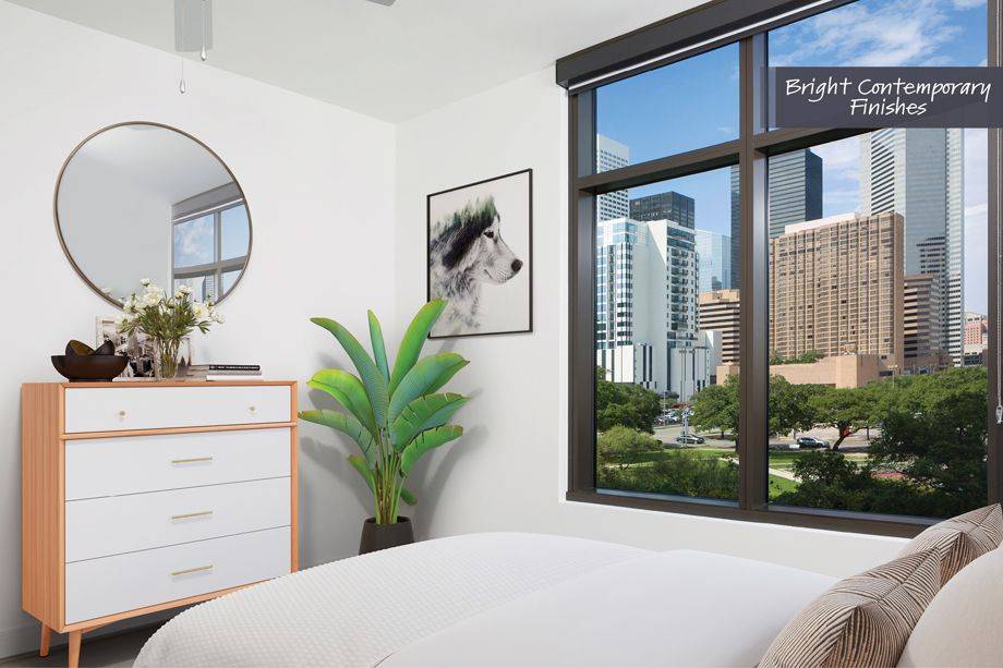 Bedroom with Downtown View in Bright Contemporary Finish Scheme at Camden Downtown Houston Apartments in Houston, Texas