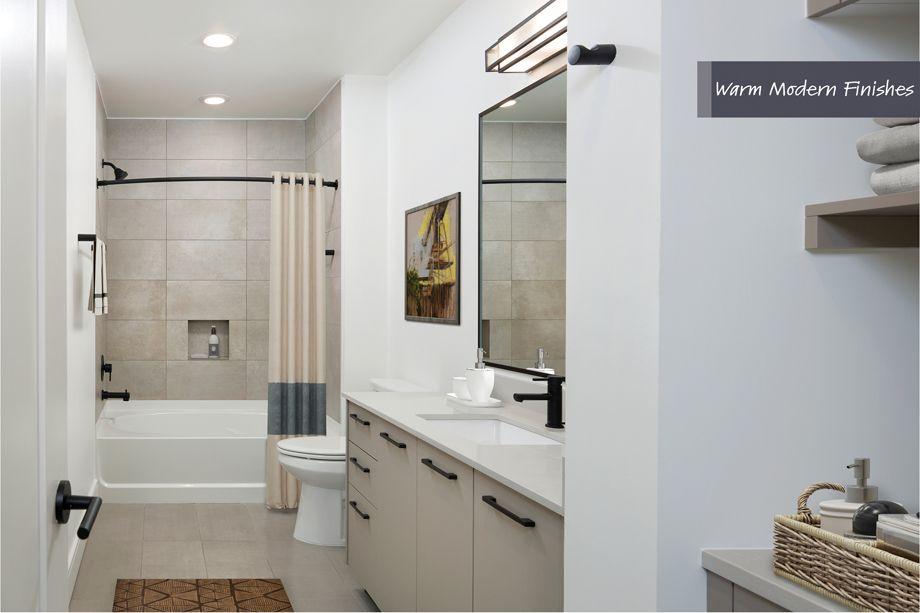 Bathroom in Warm Modern Finish Scheme at Camden Downtown Houston Apartments in Houston, Texas