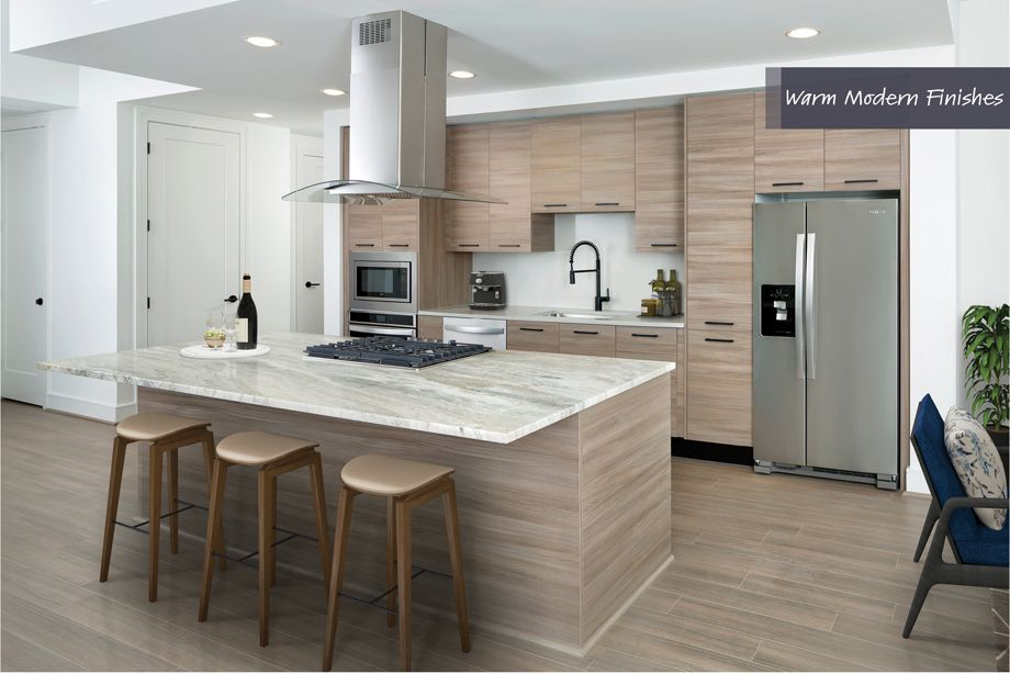 Kitchen with Gas Stove in Island in Warm Modern Finish Scheme at Camden Downtown Houston Apartments in Houston, Texas
