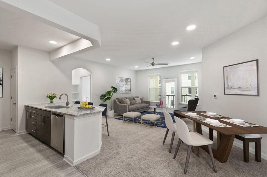 Dining area and living room at Camden Dulles Station Apartments in Herndon, VA