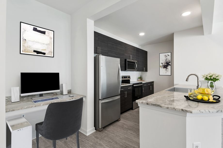 Kitchen and home office space at Camden Dulles Station Apartments in Herndon, VA