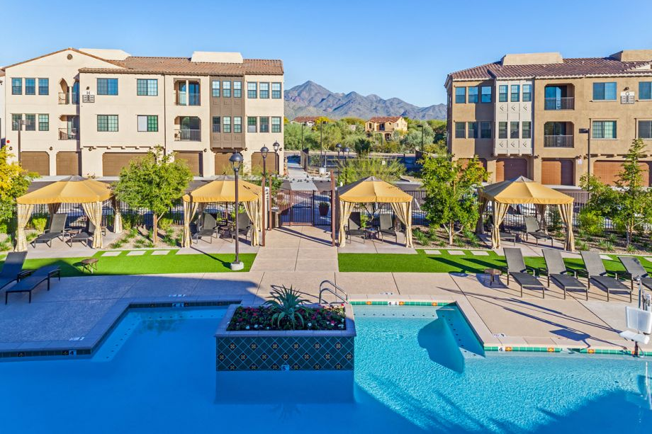 View of pool and nearby mountains at Camden Foothills Apartments in Scottsdale, AZ