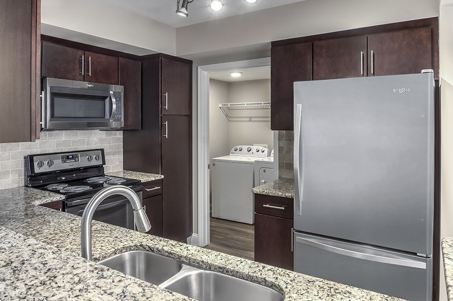 Kitchen with Stainless Steel Appliances, Granite Countertops and Full-Size Washer and Dryer Camden Grandview Apartments in Charlotte, NC