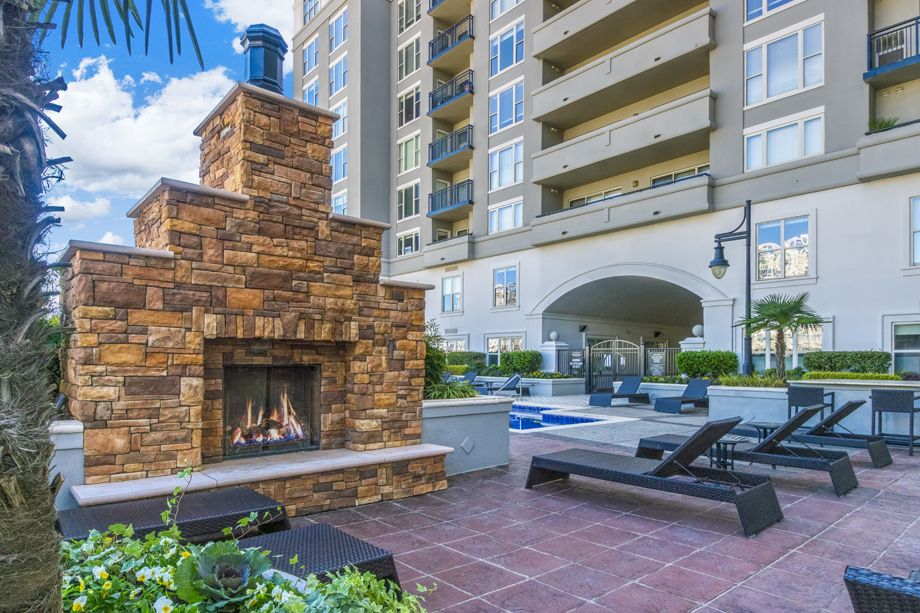 Swimming Pool with Outdoor Fireplace at Camden Grandview Apartments and Townhomes in Charlotte, NC