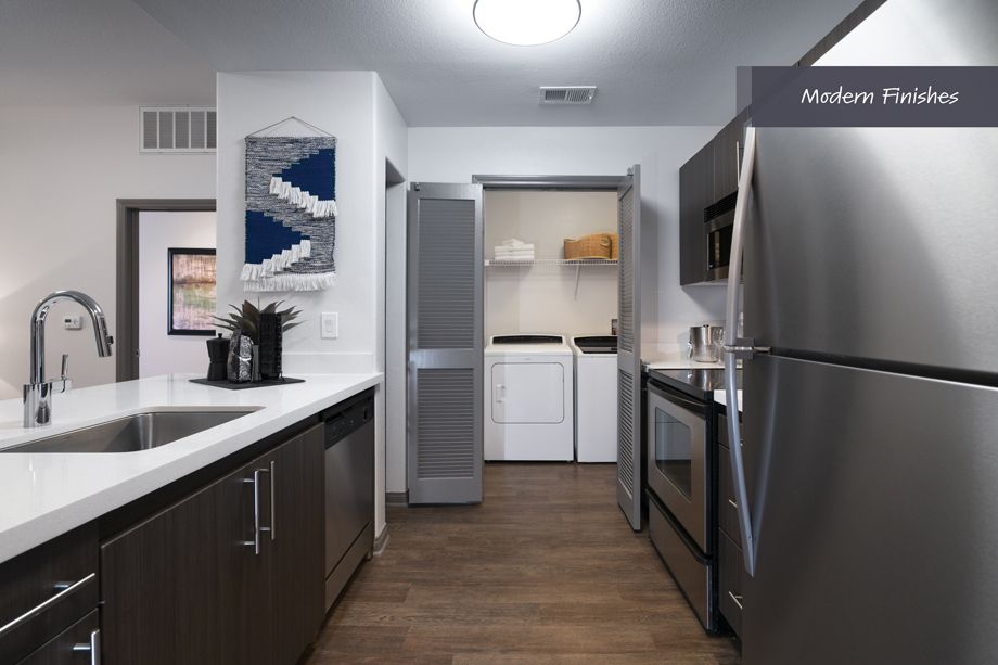 Kitchen and Laundry Area with modern finishes at Camden Harbor View Apartments in Long Beach, CA