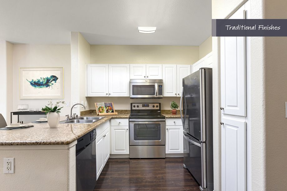 Kitchen with traditional finishes at Camden Harbor View Apartments in Long Beach, CA
