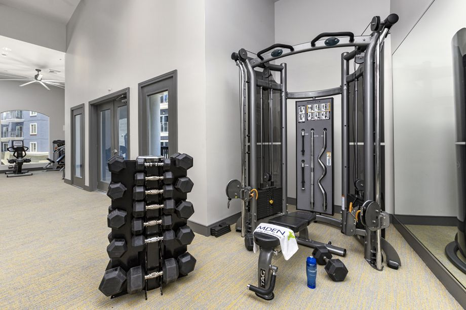 Free weights in fitness center at Camden Harbor View Apartments in Long Beach, CA