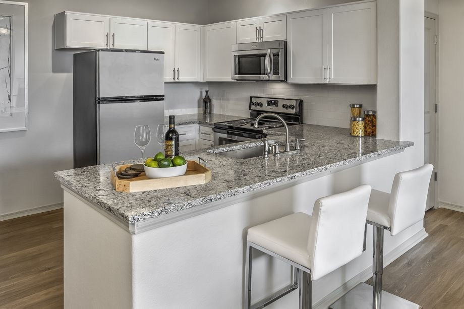 Kitchen with Breakfast Bar at Camden Interlocken Apartments in Broomfield, CO