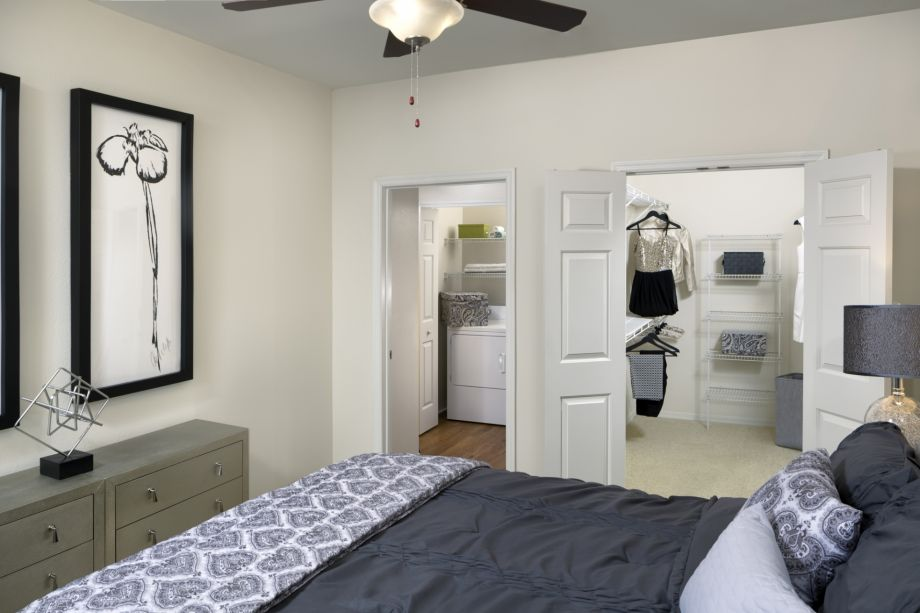 Bedroom with Closet and Laundry at Camden Lago Vista Apartments in Orlando, FL