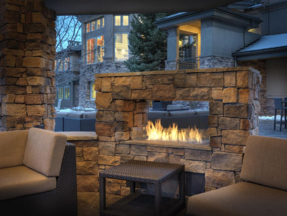 Fireside Outdoor Lounge at Camden Lakeway Apartments in Lakewood, CO