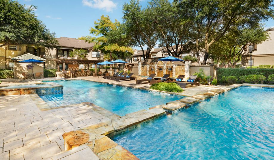 Pool with spa and sundeck at Camden Legacy Park Apartments in Plano, TX