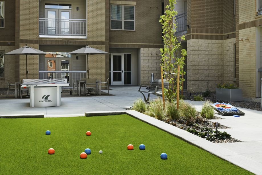 Courtyard with Lawn Games at Camden Lincoln Station Apartments in Lone Tree, CO