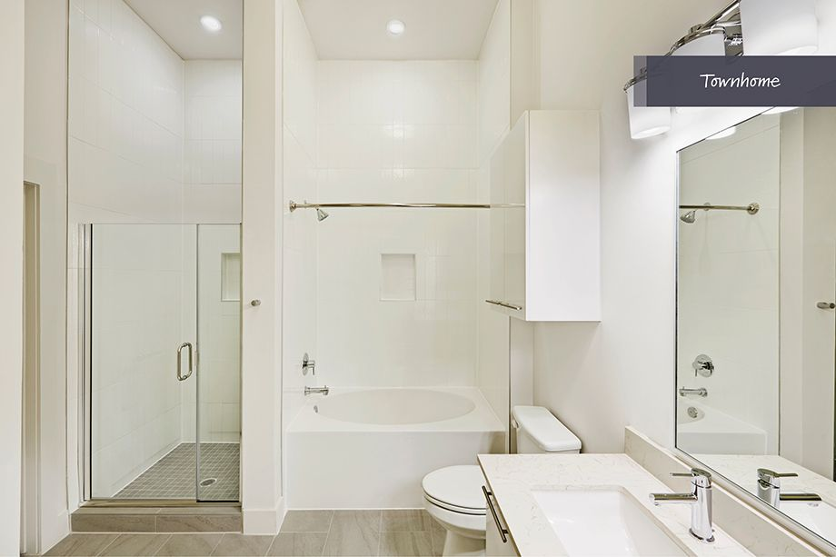 Bathroom with walkin shower and bathtub at Camden McGowen Station Townhomes