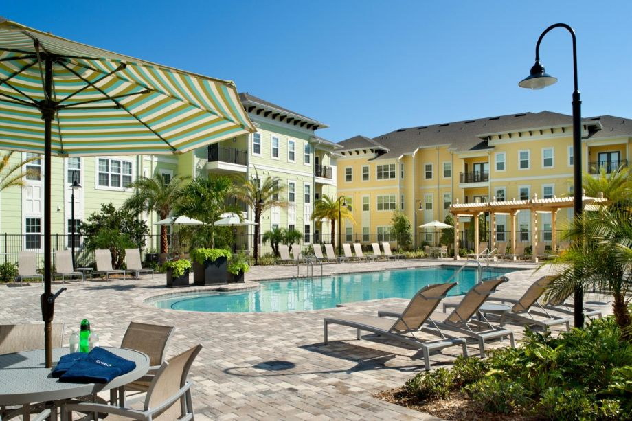 Pool with Outdoor Lounge at Camden Montague Apartments in Tampa, FL