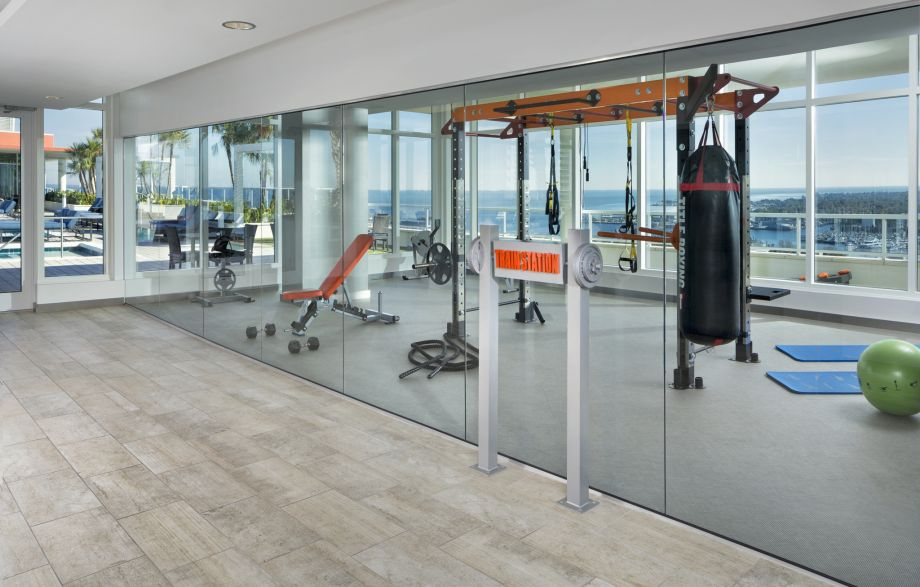 Gym with Cardio and Boxing Equipment at Camden Pier District Apartments in St. Petersburg, FL