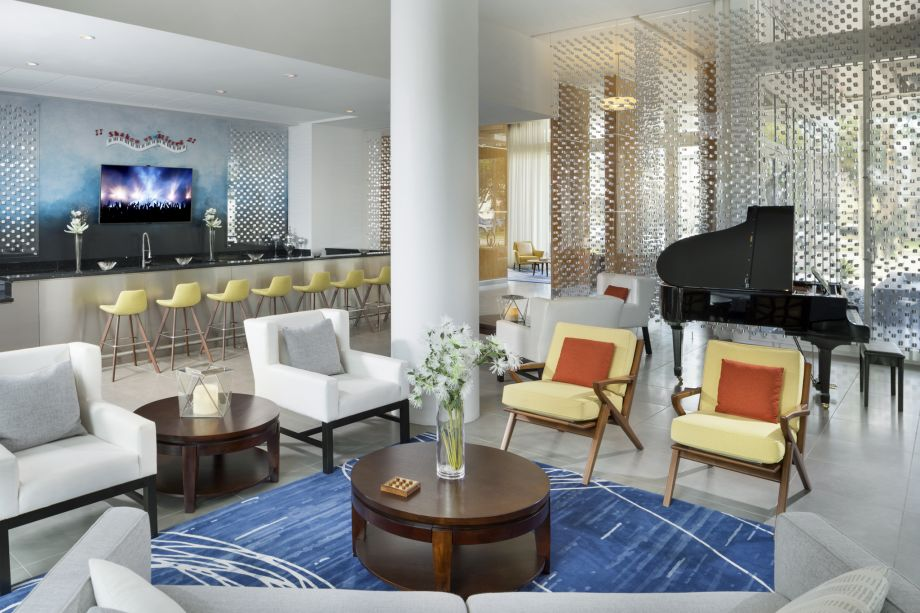 Piano Lounge at Camden Pier District Apartments in St. Petersburg, FL