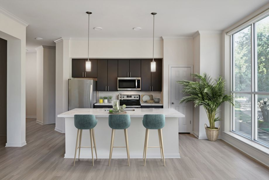Kitchen with large island at Camden Plaza Apartments in Houston, TX