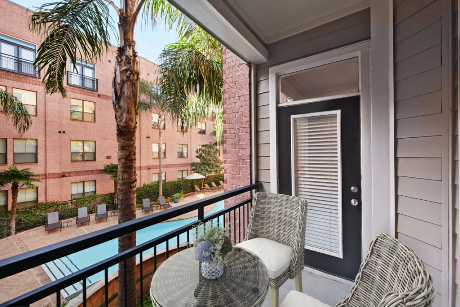 Balcony with Pool Views at Camden Plaza Apartments in Houston, TX