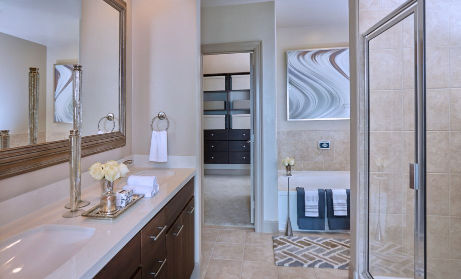 Bathroom with Double Sink Vanity, Stand-up Shower and Bathtub at Camden Post Oak Apartments in Houston, TX