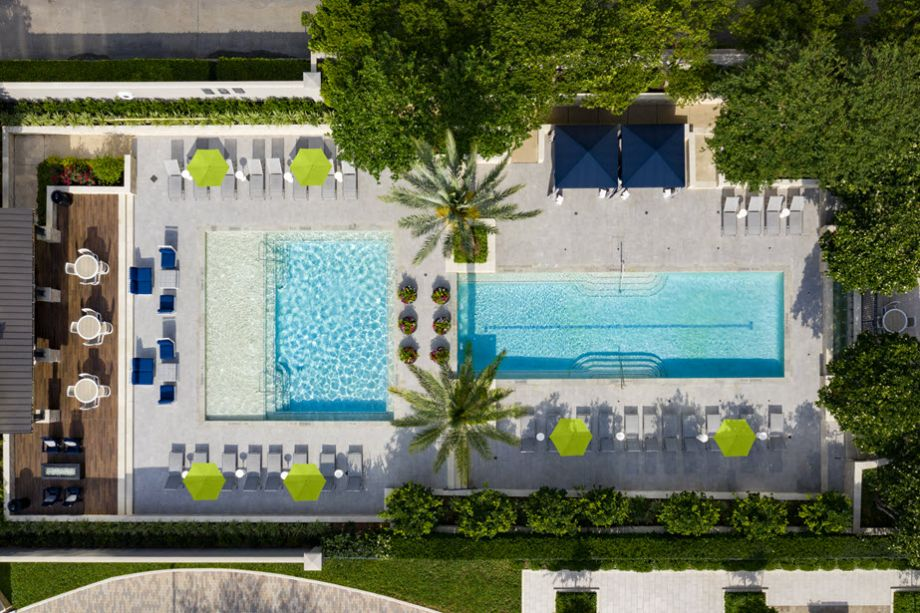 Overhead View of Swimming Pool with Sun Deck, Cabanas and Outdoor Dining Space at Camden Post Oak Apartments in Houston, TX