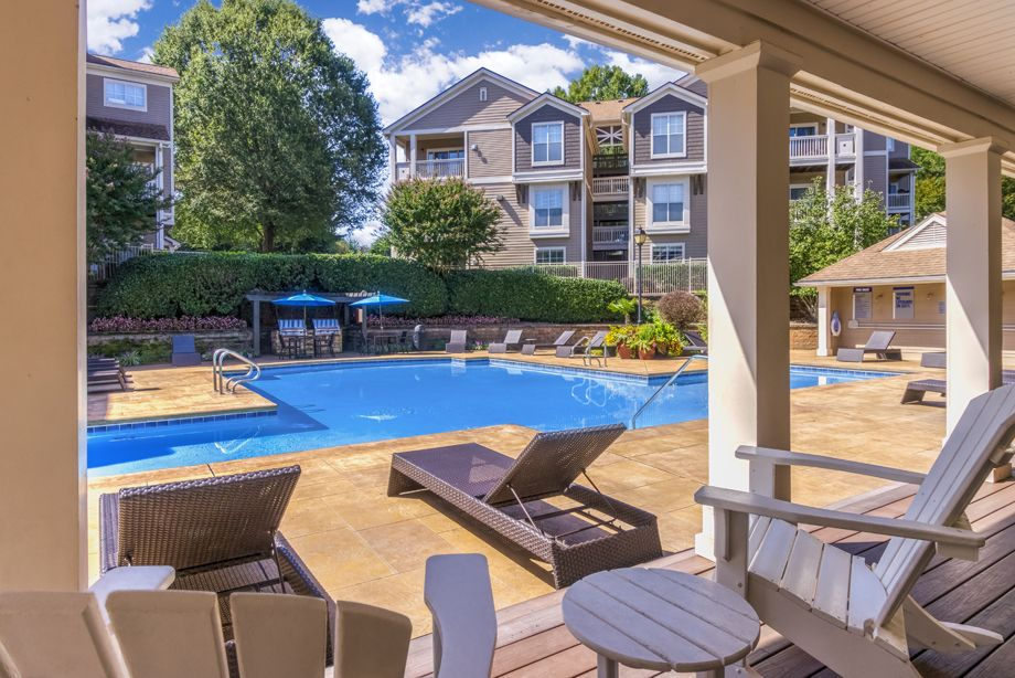 Lounge seating at the pool at Camden Sedgebrook Apartments in Huntersville, NC