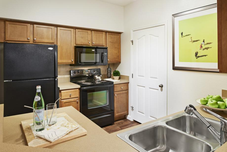 Kitchen with Wood-style Flooring at Camden South Bay Apartments in Corpus Christi, TX