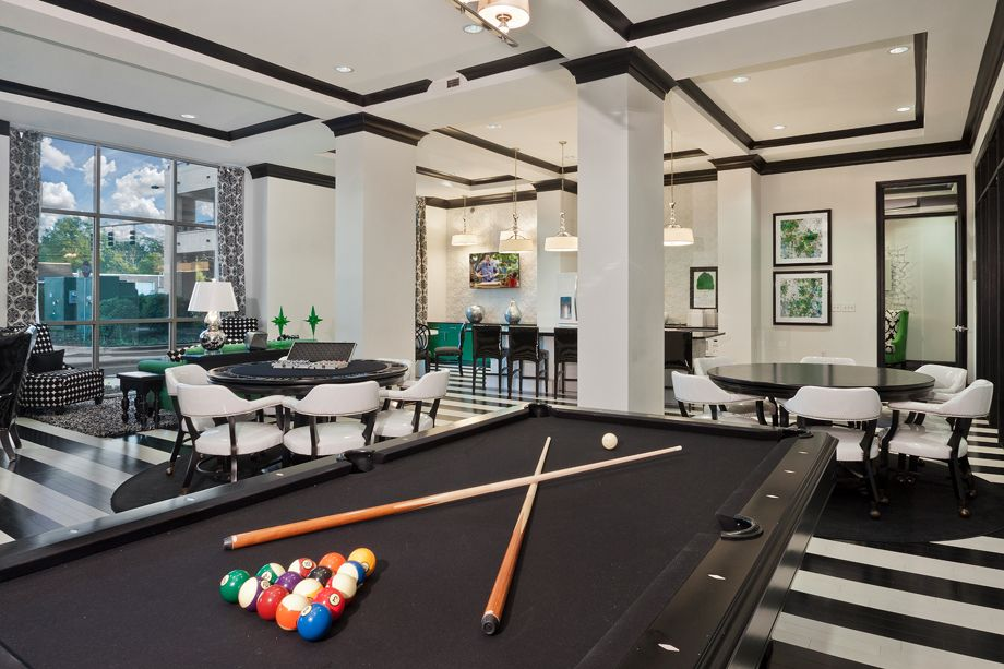 Resident lounge with billiards table at Camden Southline apartments in Charlotte, NC
