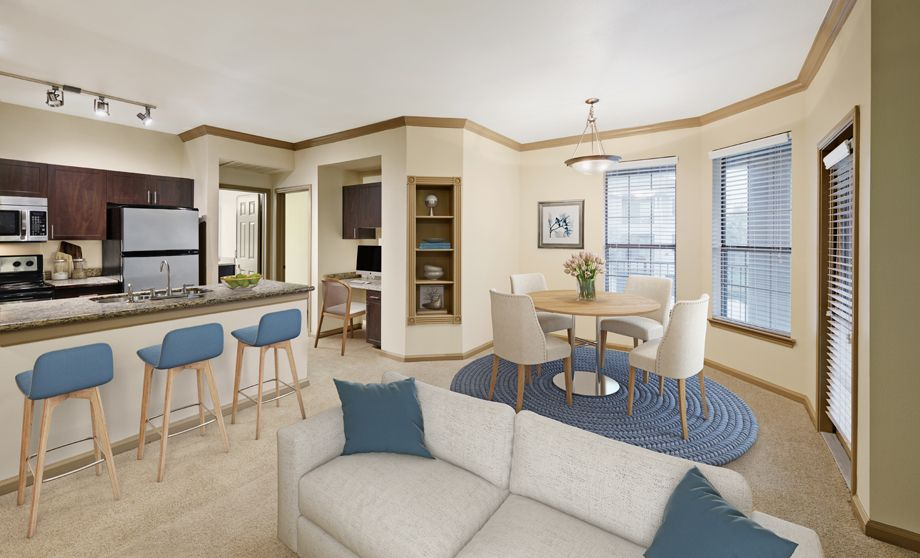 Living room and kitchen at Camden Stoneleigh Apartments in Austin, TX