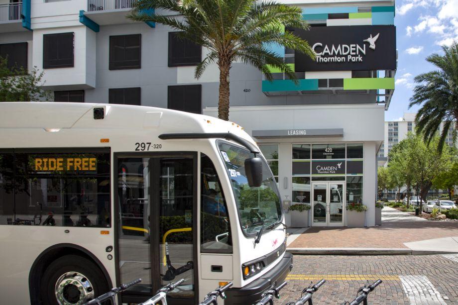 Exterior apartments and public transportation at Camden Thornton Park Apartments in Orlando, FL