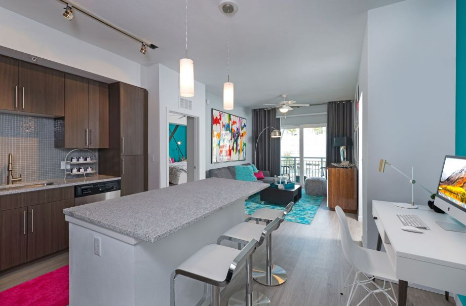 Open-Concept Kitchen, Dining and Living in Two Bedroom Apartment Home at Camden Thornton Park Apartments in Orlando, FL