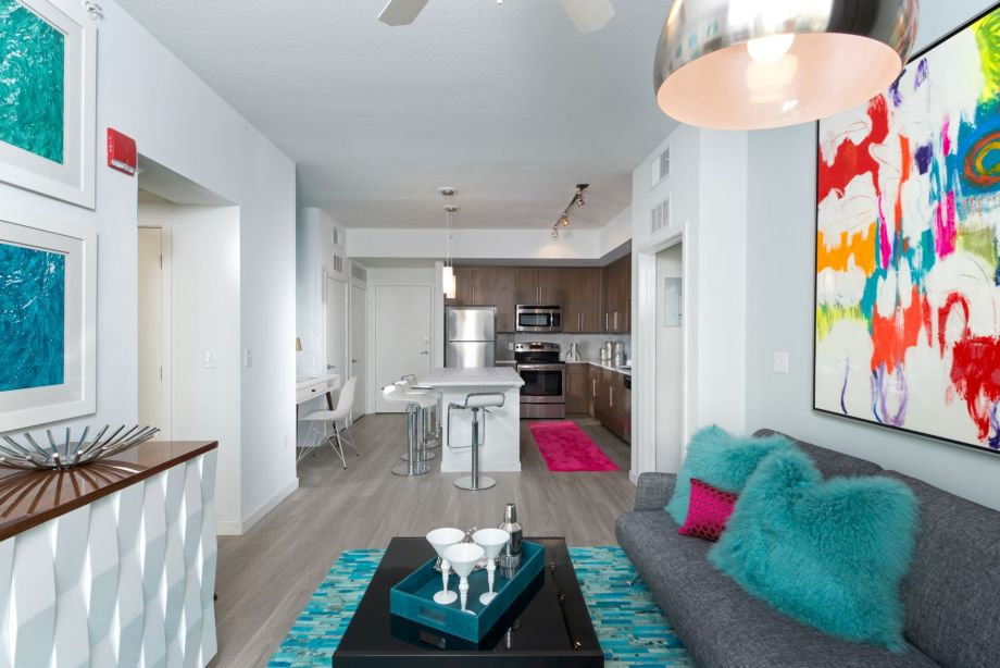 Open-Concept Living Room and Kitchen in Two Bedroom Apartment Home at Camden Thornton Park Apartments in Orlando, FL