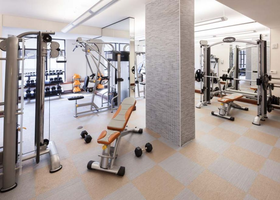 Fitness Center with Cardio Equipment and Free Weights at Camden Post Oak High Rise Luxury Apartments in Houston Galleria, Texas
