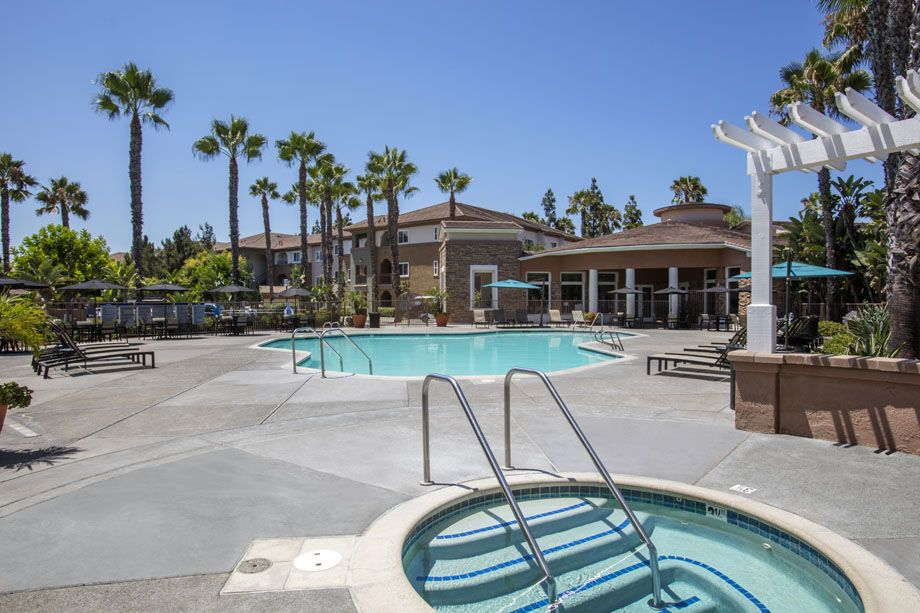 Resort-style swimming pool with jacuzzi at Camden Sierra at Otay Ranch apartments in Chula Vista, CA
