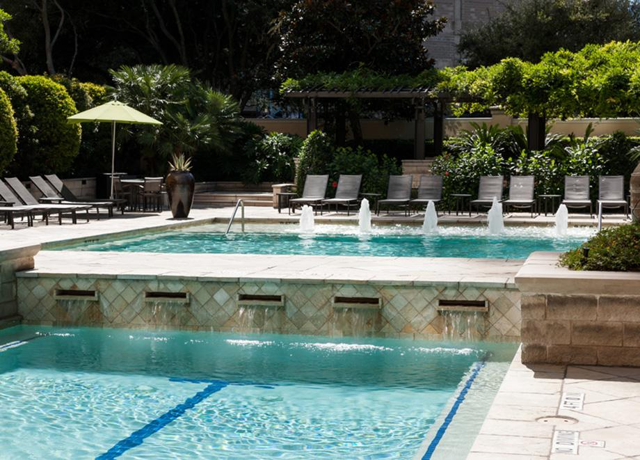Swimming Pool with Lap Lane and Water Features at Camden Post Oak High Rise Luxury Apartments in Houston Galleria, Texas