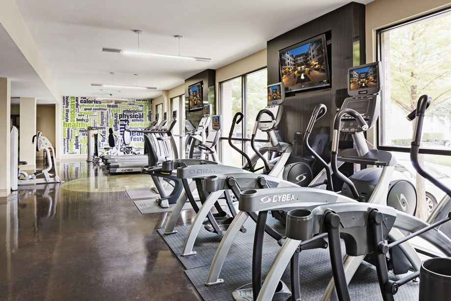 Fitness center with cardio machines at Camden Belmont apartments in Dallas, TX