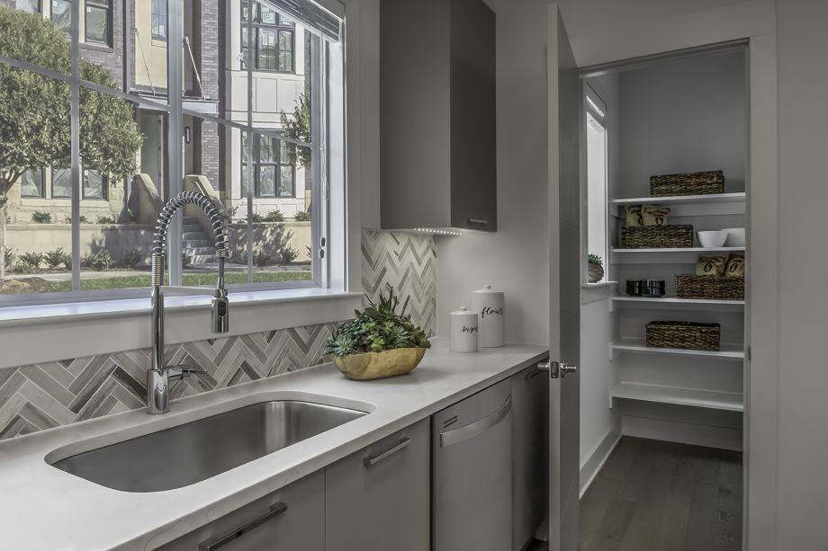 Kitchen with walk-in pantry at Camden Grandview Townhomes in Charlotte, NC