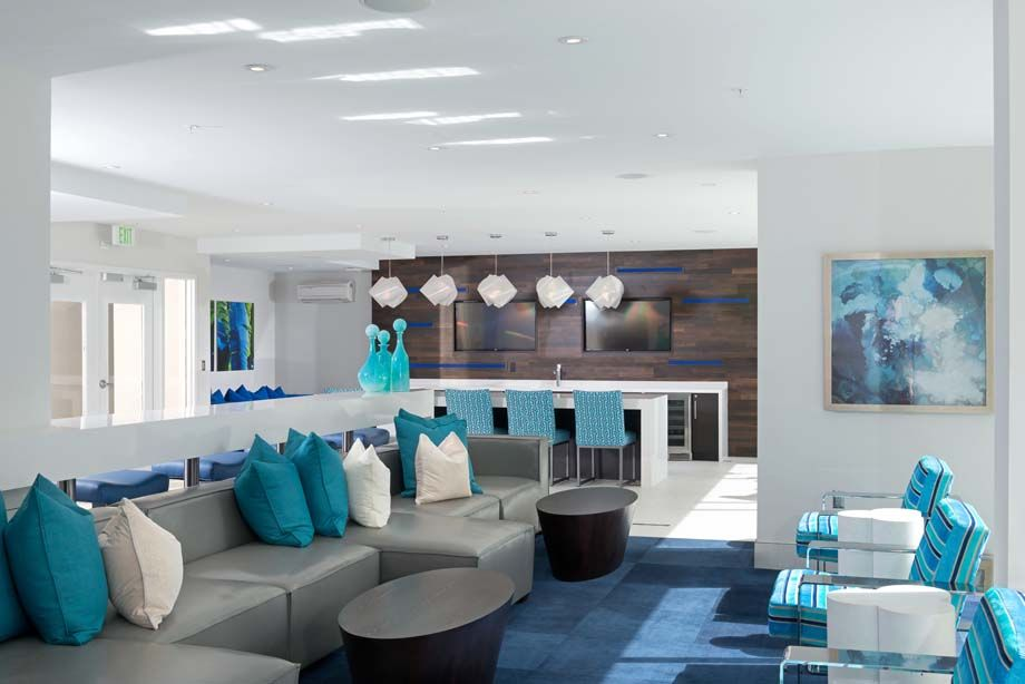 Clubroom with lounge seating at Camden Thornton Park apartments in Orlando, FL