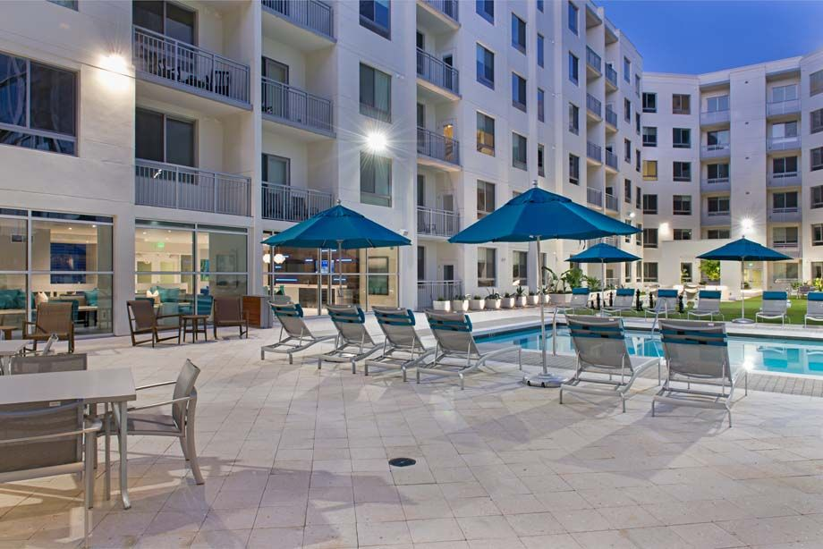 Amenity deck at dusk at Camden Thornton Park apartments in Orlando, FL