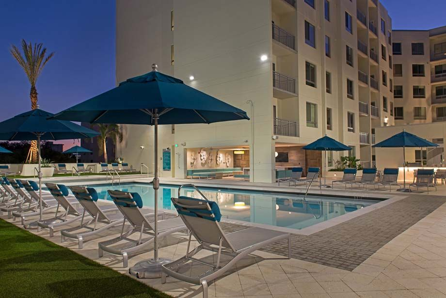 Resort-style swimming pool with lounge chairs at Camden Thornton Park apartments in Orlando, FL