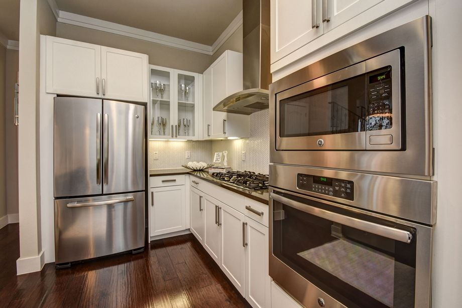 Kitchen with stainless steel appliances at Camden Highland Village townhomes in Houston, TX