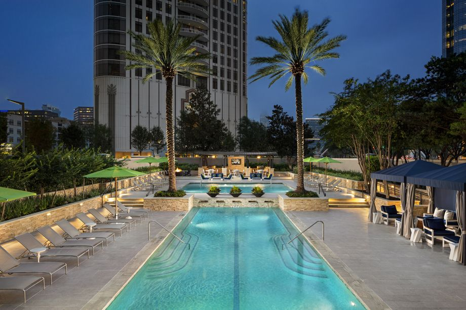 Twilight by the Swimming Pool at Camden Post Oak High Rise Luxury Apartments